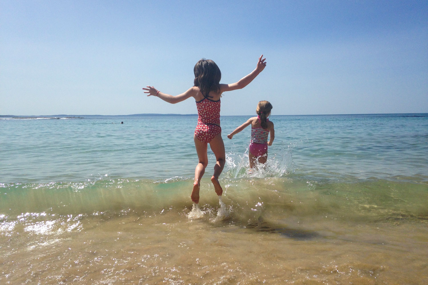 Claudia-and-Marisa-jumping-waves.jpg