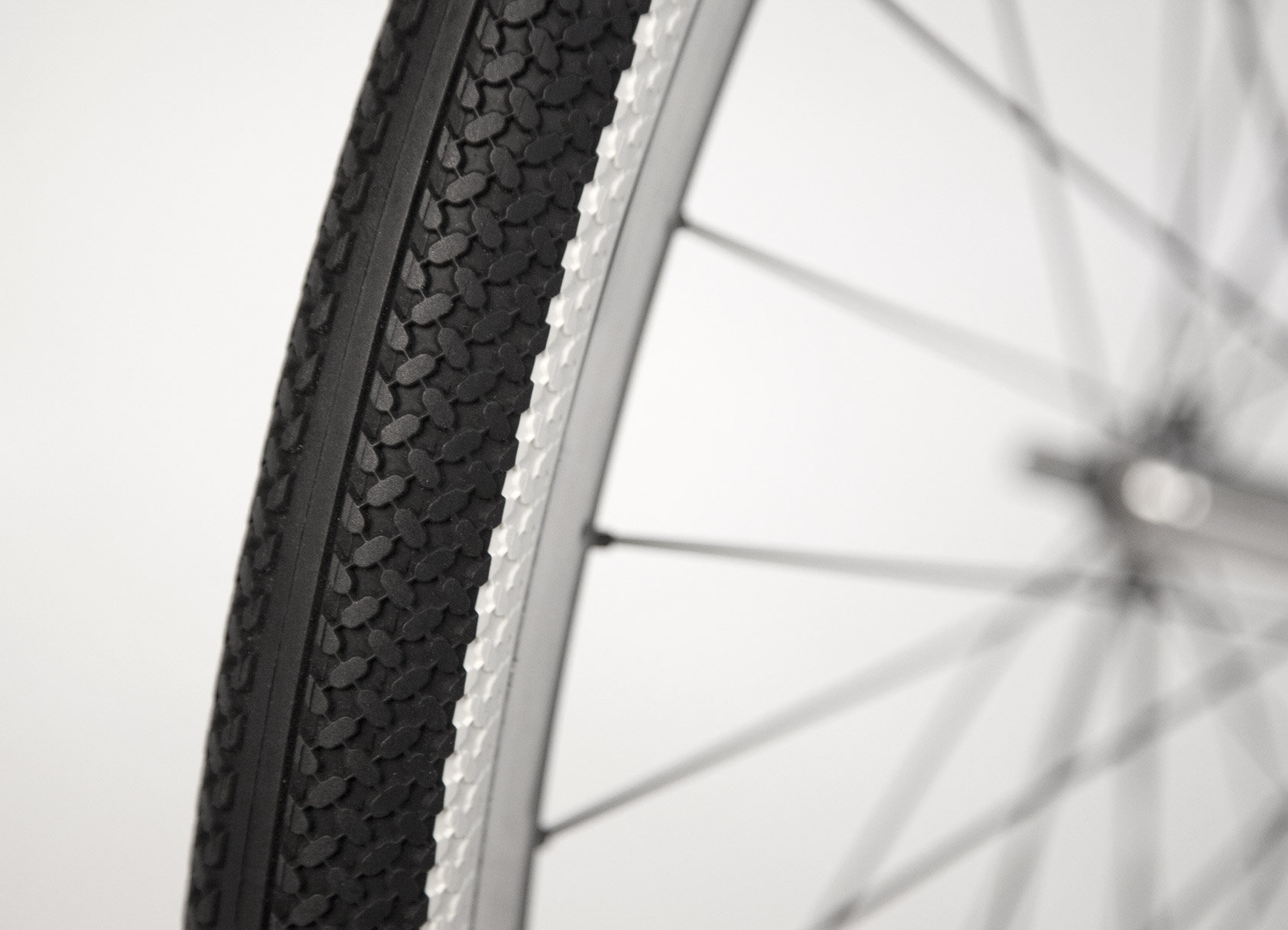 Tire - Puncture-proof, double fused wall.