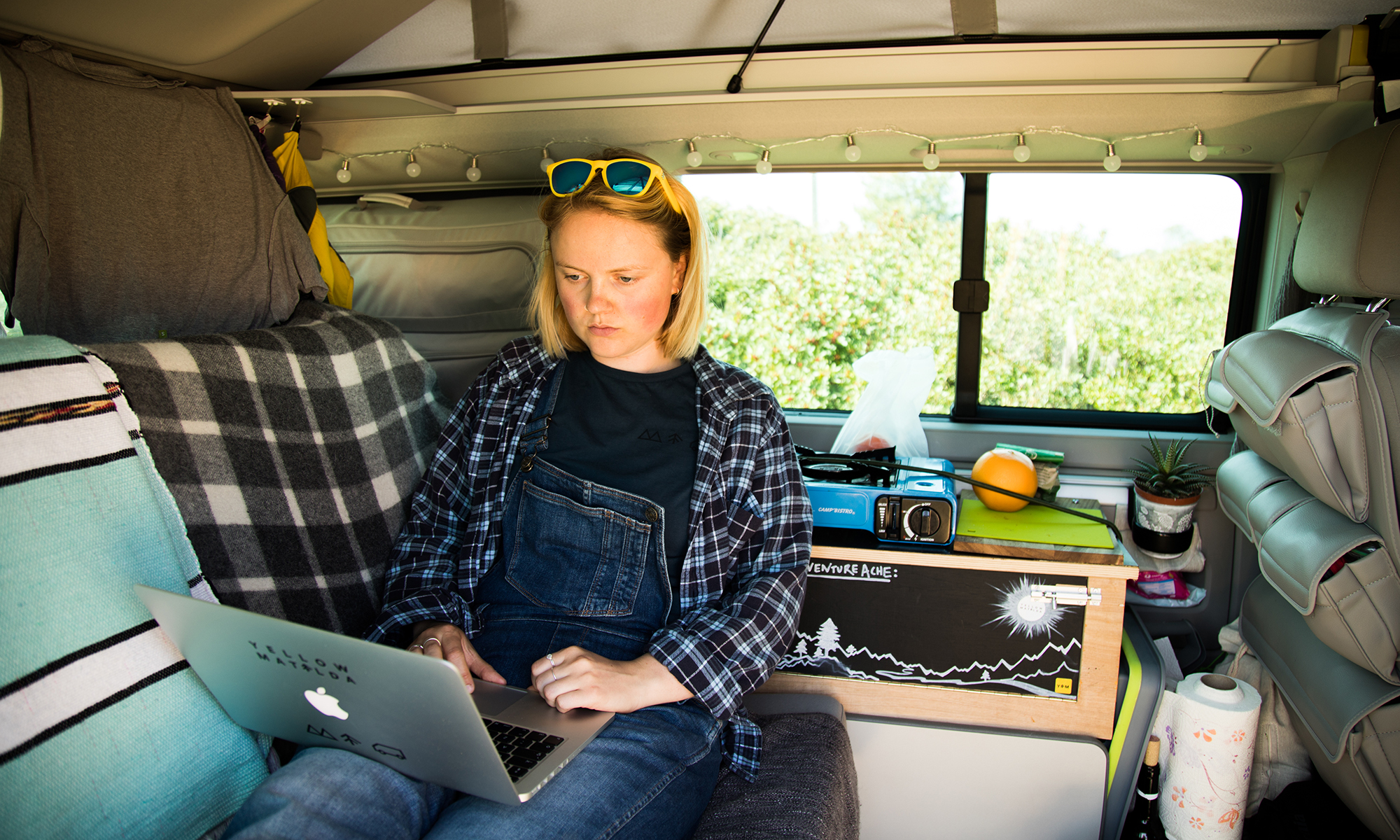 LAURA'S STORY - Laura is a freelance graphic designer and works her way around the world in her bright yellow campervan… who said design was a desk job!