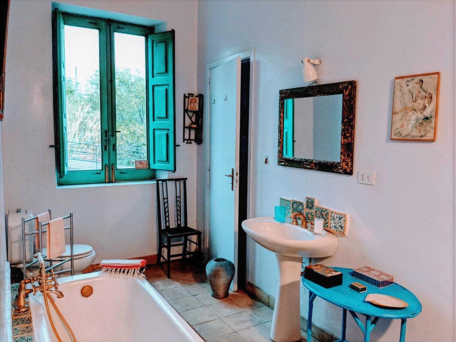 63 bathroom blue landscape 3 villa ama sicily.jpg