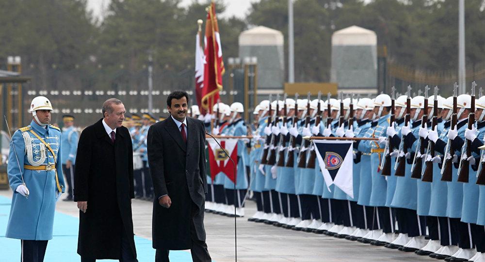 President Recep Tayyip Erdoğan of Turkey (left) and DescriptionSheikh Tamim bin Hamad Al Thani of Qatar (right).