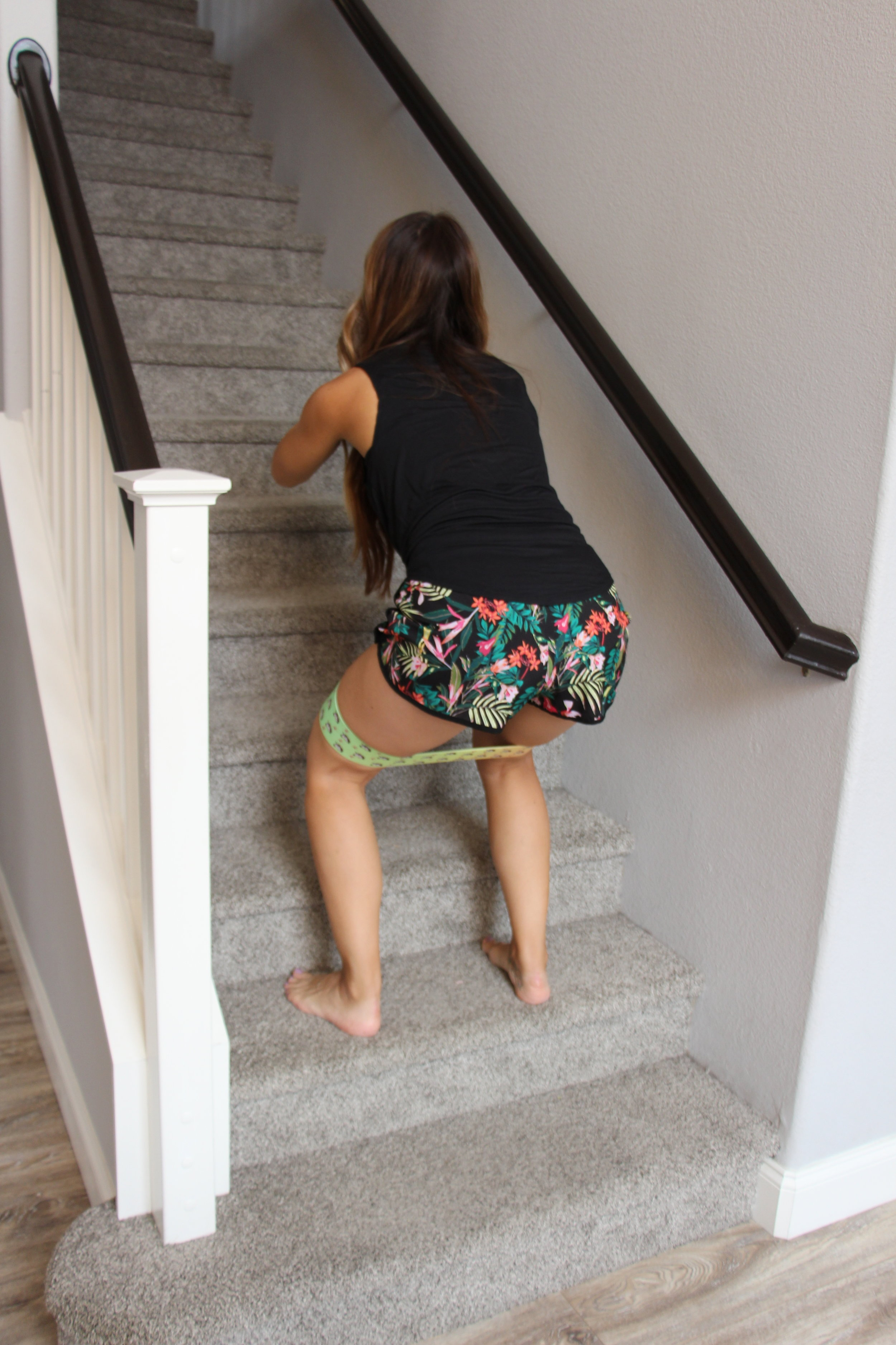 - Using a Medium band you can do a stationary squat or you can squat up the stairs.
