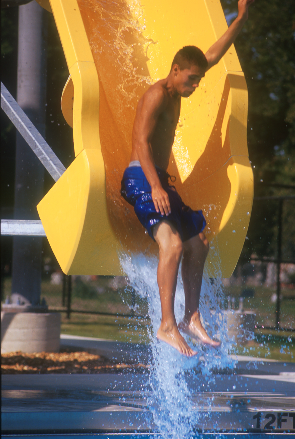 2005-025-Schiller-Park-older-kid-bottom-of-plunge-slide.jpeg