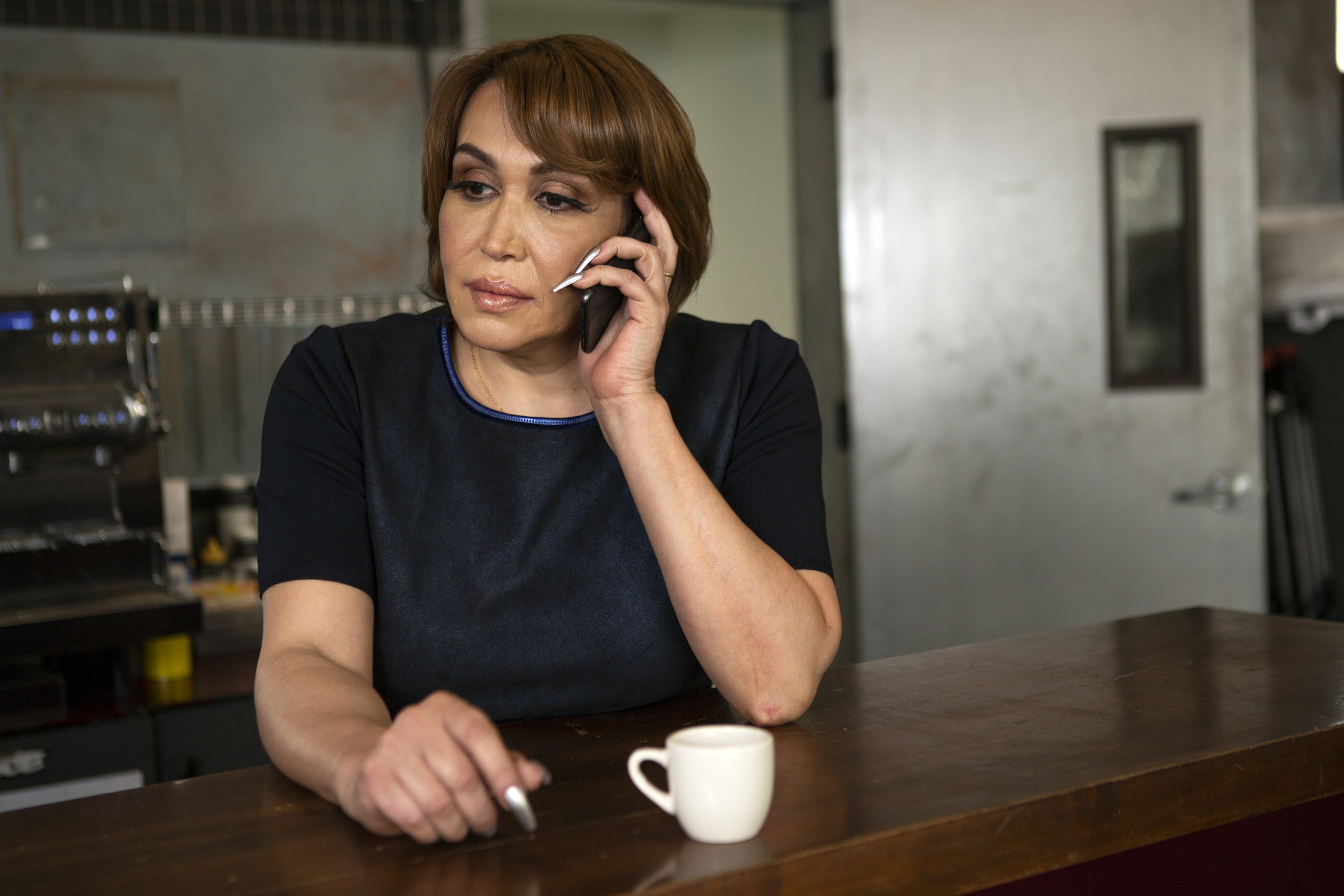 A transgender woman on the phone.jpg