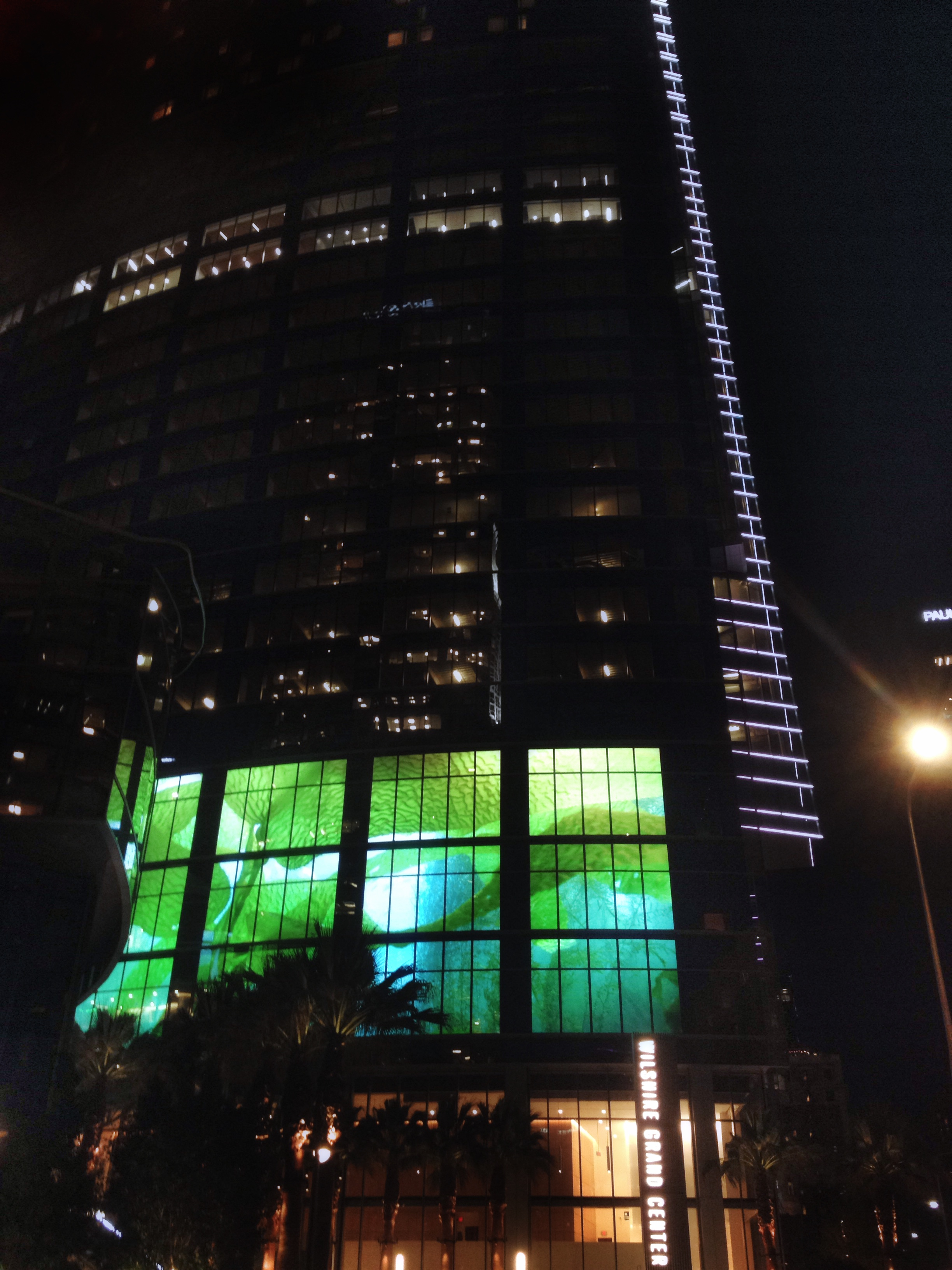 Wilshire Grand - Designer for the StandardVision award winning lighting installations on Wilshire Grand including the linear narrative lighting, courtyard media screen as well as digitally programmable tenant signage situated within the building crown