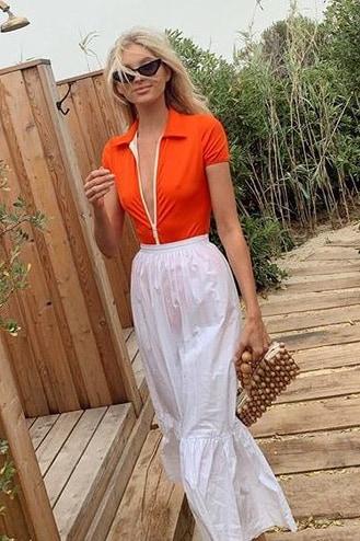 elsa-hosk-solid-and-striped-orange-bodysuit.jpg