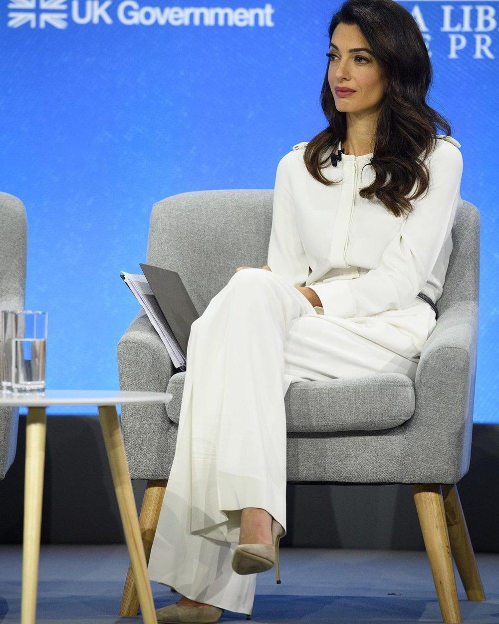 amal-clooney-stella-mccartney-white-jumpsuit-at-global-conference.jpg