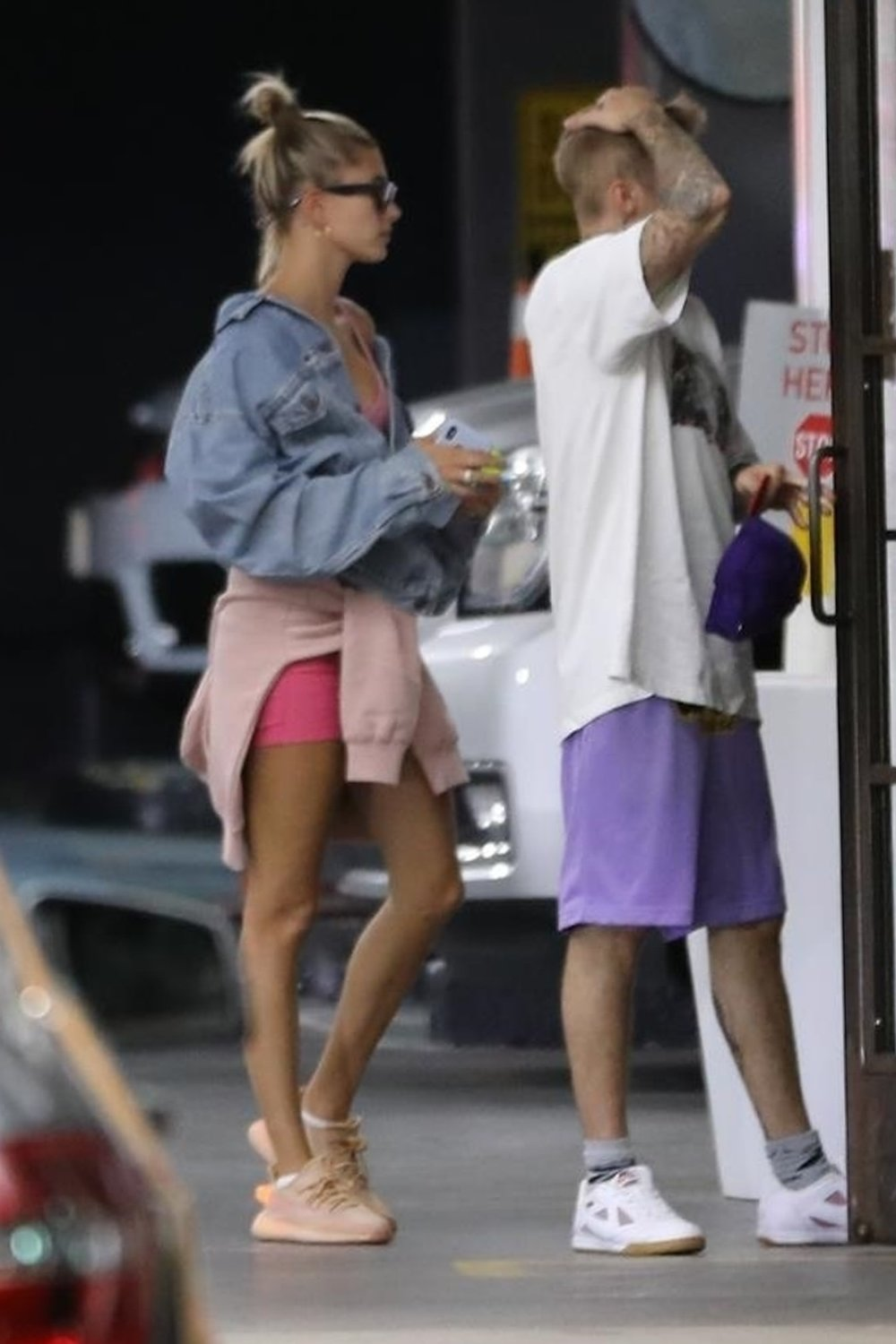 hailey-bieber-pink-shorts-and-sneakers-in-soho.jpg