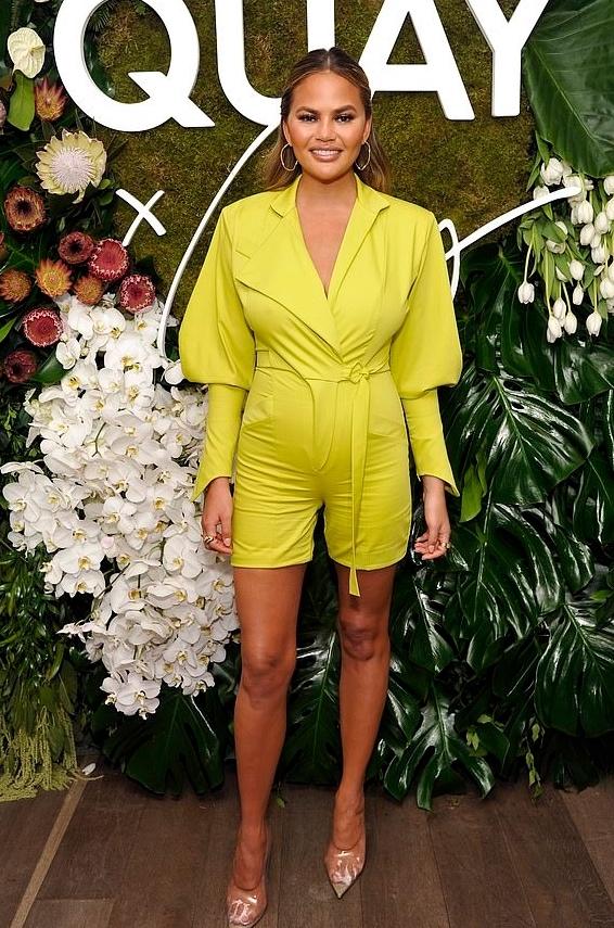 chrissy-teigen-yellow-jumpsuit-quay.jpg
