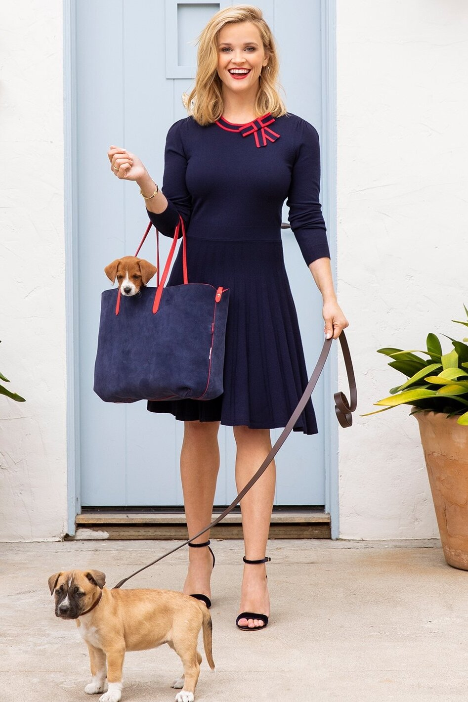 reese-witherspoon-draper-james-navy-dress-and-suede-leather-tote.jpg