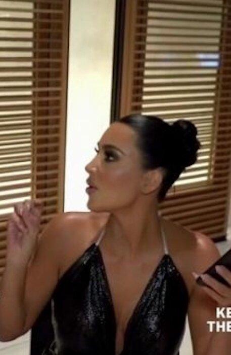 kim-kardashian-black-cowl-halter-top-keeping-up-with-the-kardashians-18.jpg