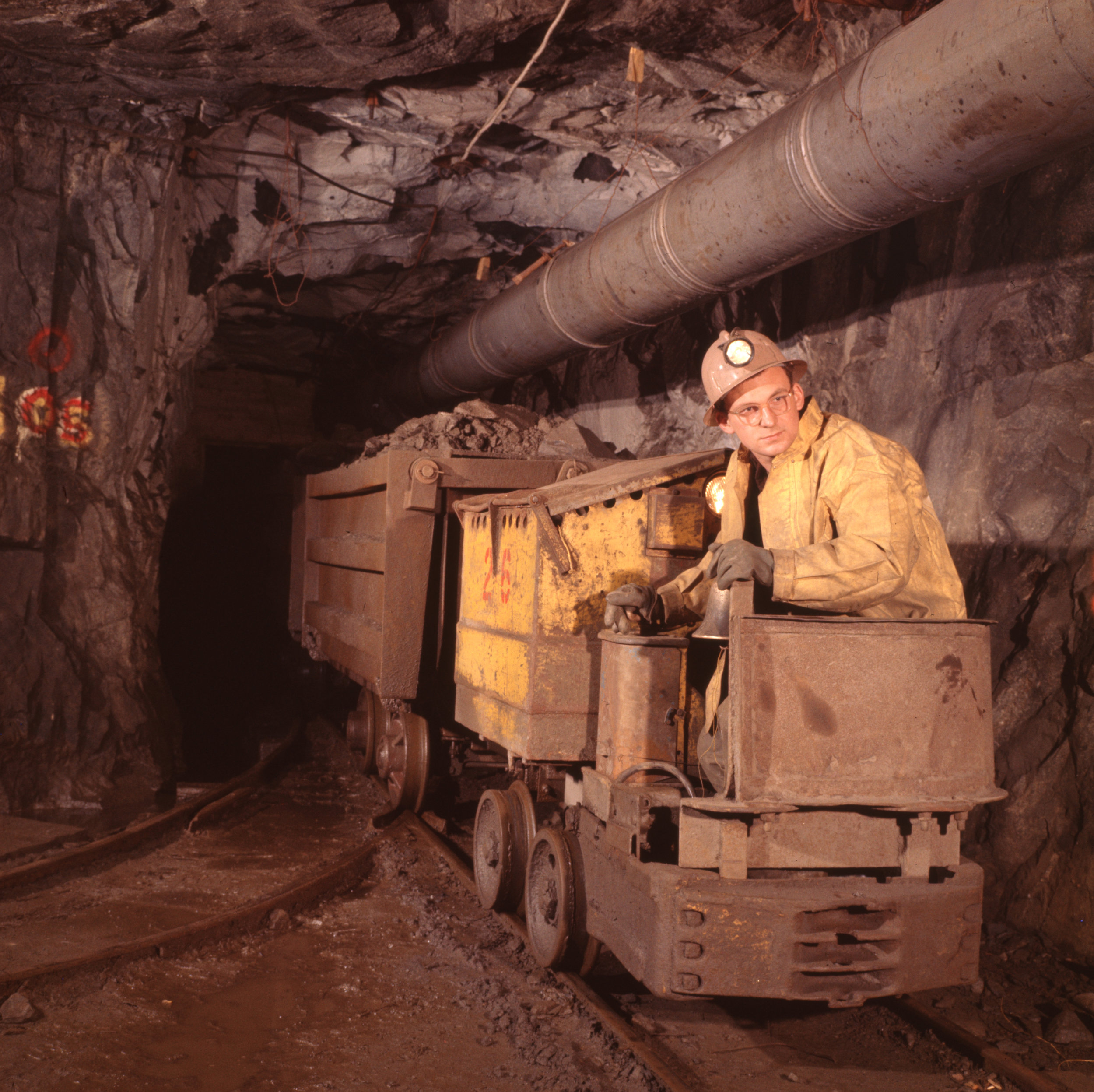 Trammer at a junction in a base metals mine.