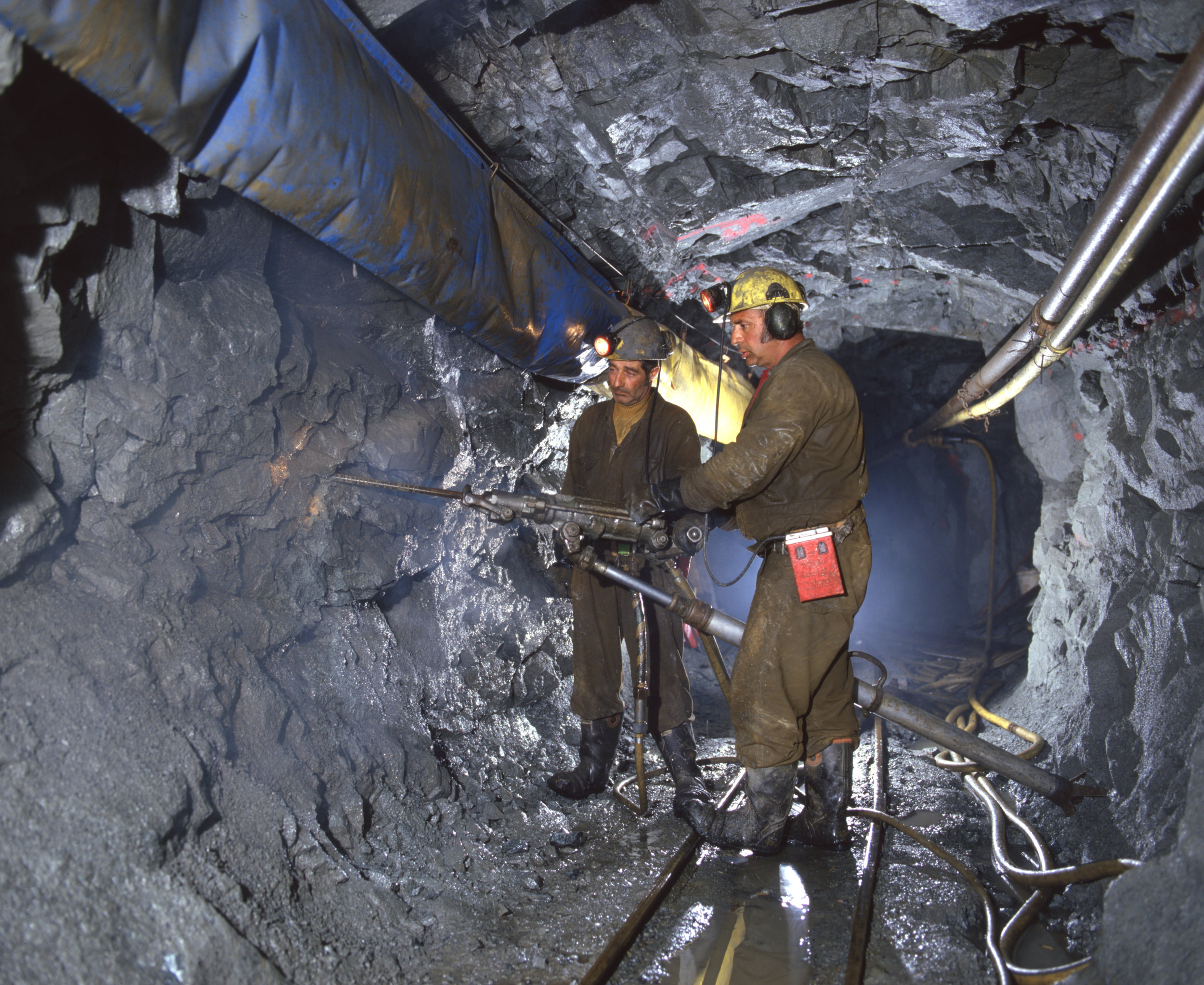 Driller and assistant, with jackleg drill commence crosscut at a small gold mine.