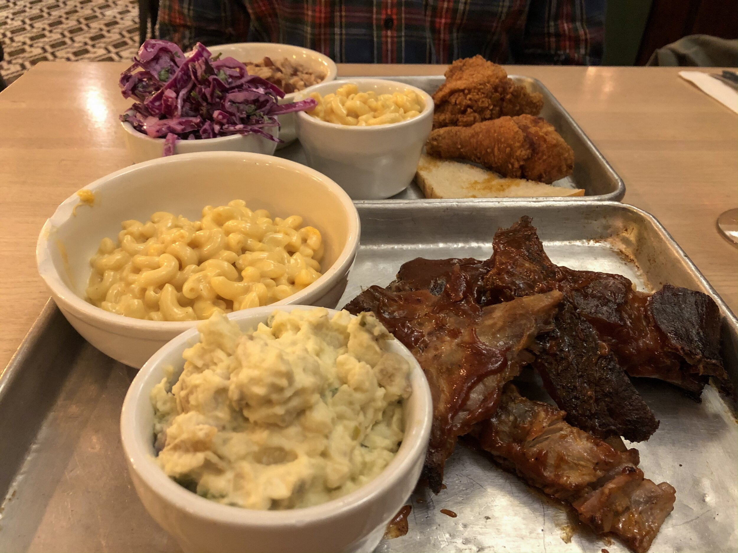 Milwaukee Hot Chicken with Red Beans & Rice, Coleslaw, and Mac & Cheese (back) and Spare Ribs with Mac & Cheese and Potato Salad