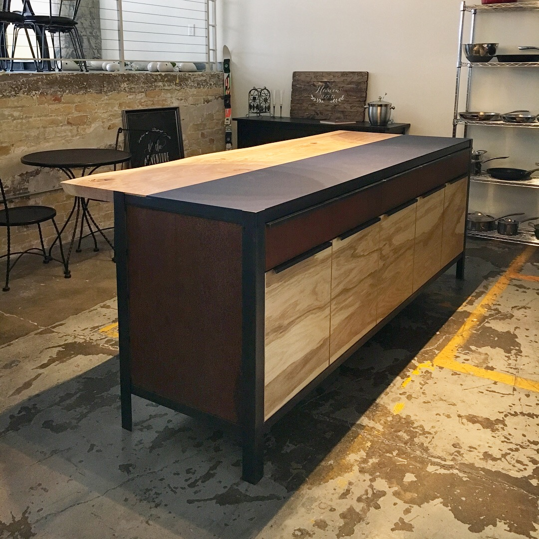 Custom kitchen island with steel frame, corten steel panels, and live edge ash top.