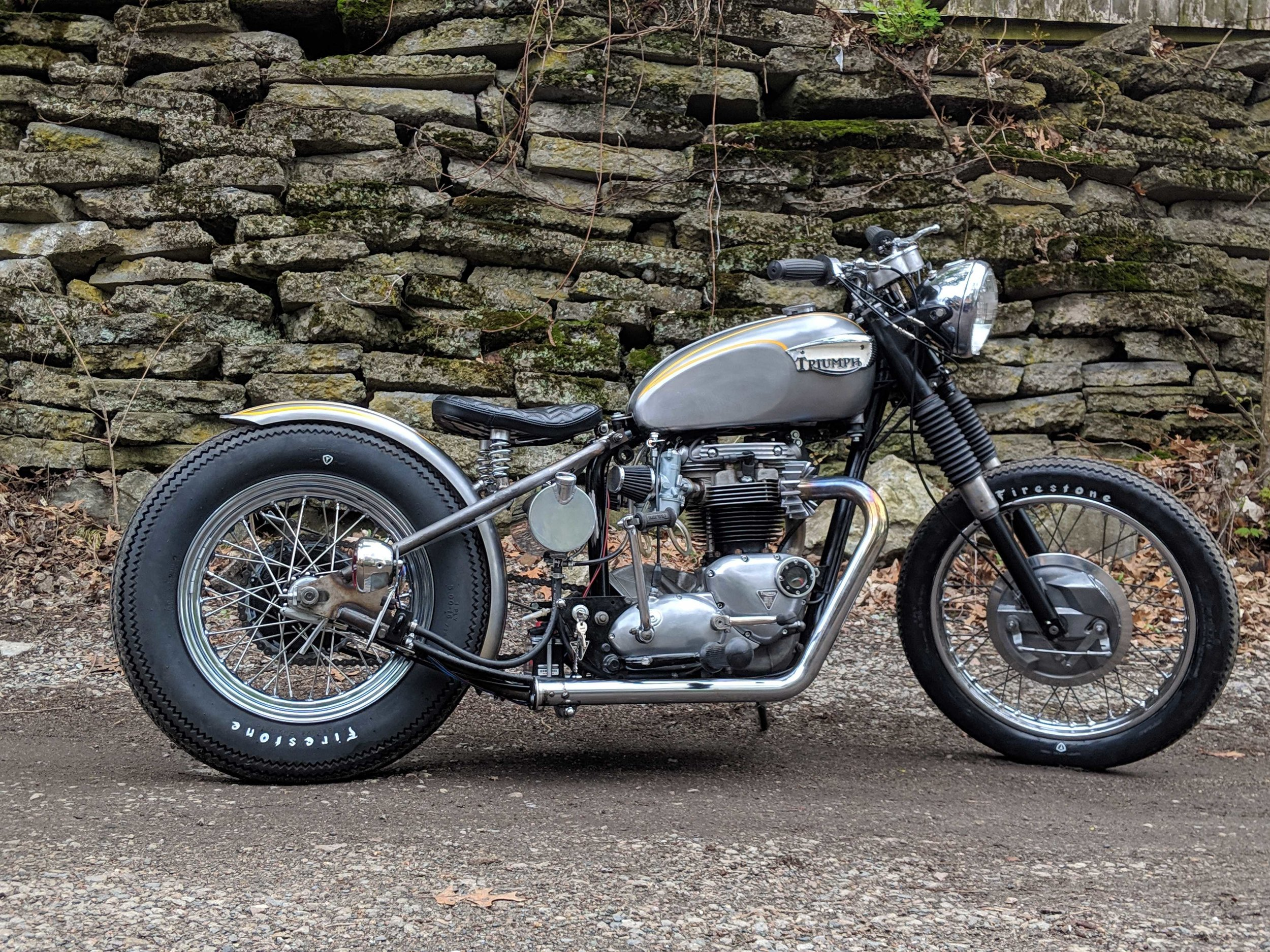 The story, straight from a first time builder… - Sylvie started life as a 1968 Triumph Bonneville T120 650cc. By the time I found her, the frame and motor no longer matched – both from 1968, but not originally paired together. Common enough with these old bikes. The tank was from a TR6, the parcel grid was from a pre-unit Triumph and the front end was upgraded to a 1969 twin leading shoe drum brake. I note all this because I had plans to do some major changes, so I was on the look for a project bike that wasn't a resto quality survivor. It would be a sin to do what I did to her if she were a barn fresh, all original matching bike. Sylvie ran, and was complete, and the price was right – so I popped on her.