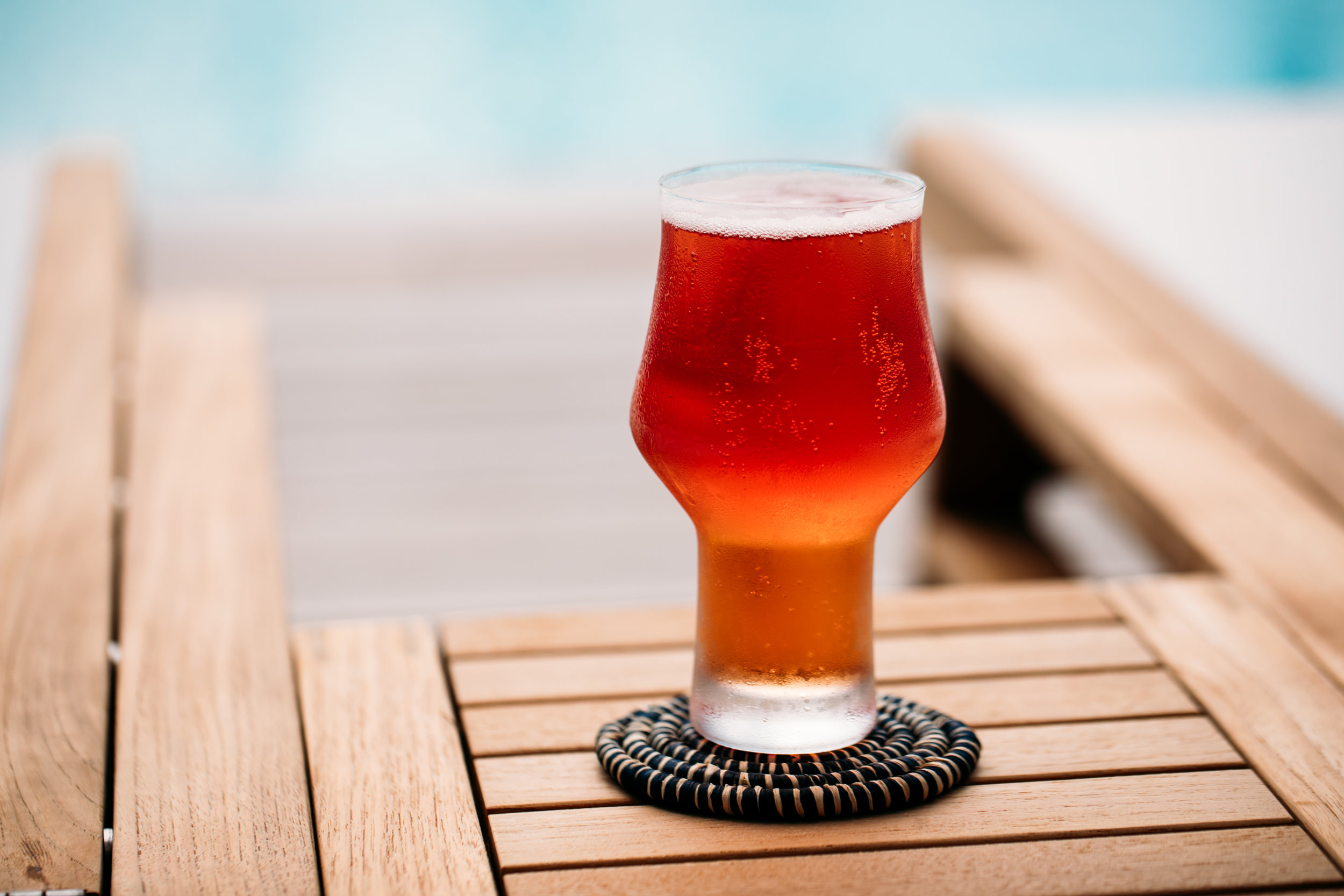 Beer in fancy glass with coaster