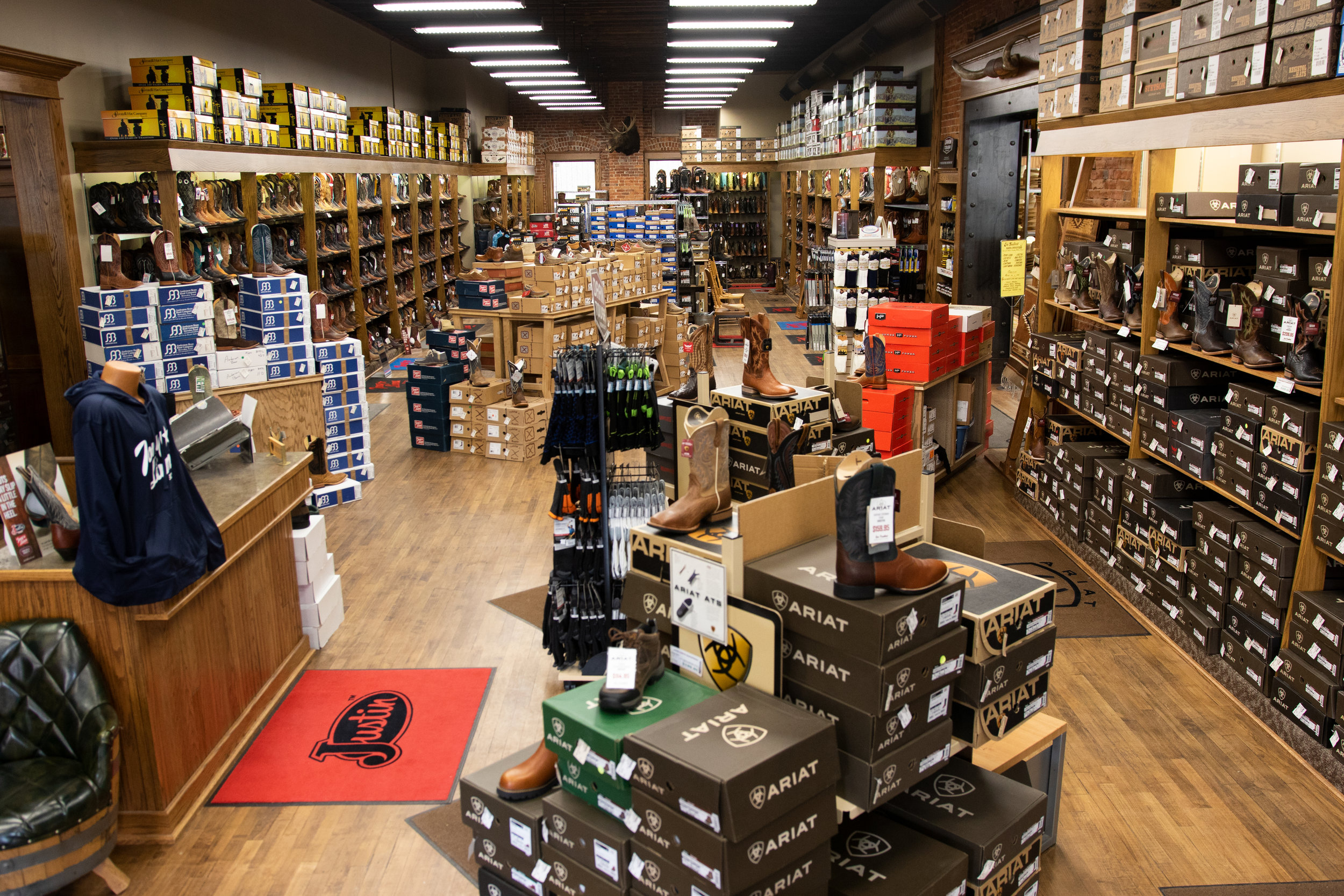 """The Boot Room"" - Boots for riding or walking, dress or work, we've got something in stock for you. We carry the brands you know and trust, even in hard-to-find sizes. Come let us find you the perfect fit."