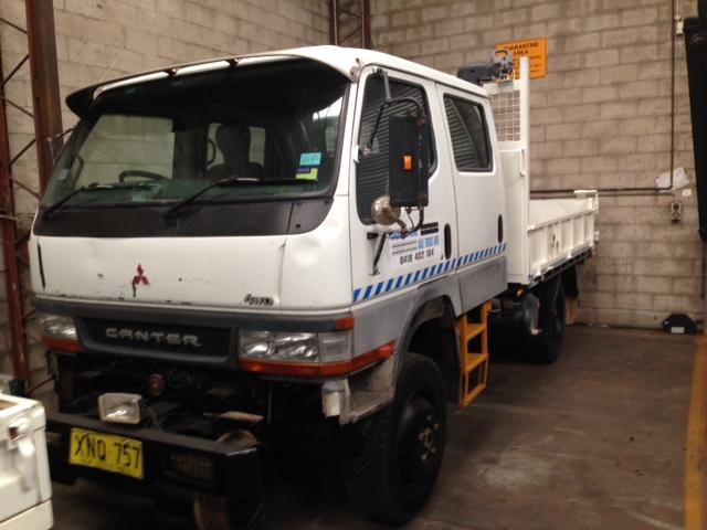 XNQ757-Mitsubishi-Canter.-Hirail-Dual-Cab-4WD-3-Way-Tipper-1jpg.jpg