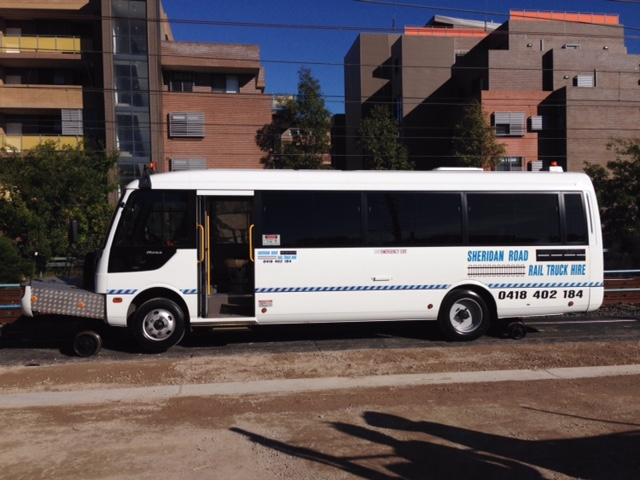 TRAINU-Mitsubish-Rosa-Hirail-Bus-22-Seat-Wheelchair-1.jpg
