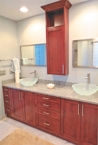 Complete renovation of master bathroom, keeping a light open look to expand room size. Extensive storage with graduated drawer sizes, appliance plugs, display/storage floating cabinet and jewelry safe worked interior design.
