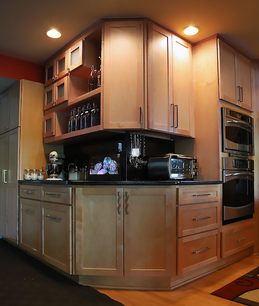 Large serving surface for parties! Lots of display in framed glass windows and open shelves. Extra storage in doors and drawers, even on angles. Storage closet worked into unit.