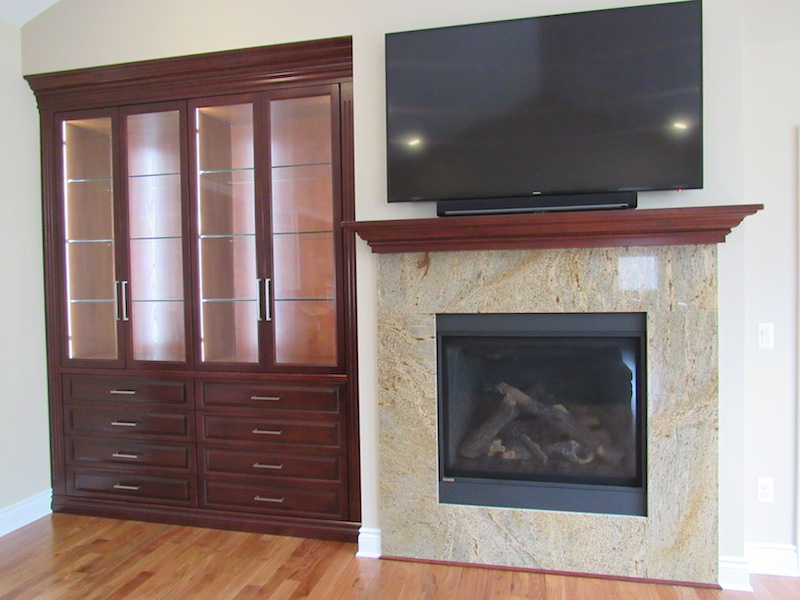 This lighting alcove display wall unit provides plenty of storage, plus a wonderful display on thick glass shelves! This complementary fireplace mantel fits right into the décor.