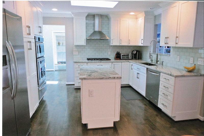 Renovation of kitchen, removing peninsula, adding storage island, access now to room on other side of sink, two pantries, entrance display, excessive storage + crown molding give room immediate appeal and is a pleasure to look at.