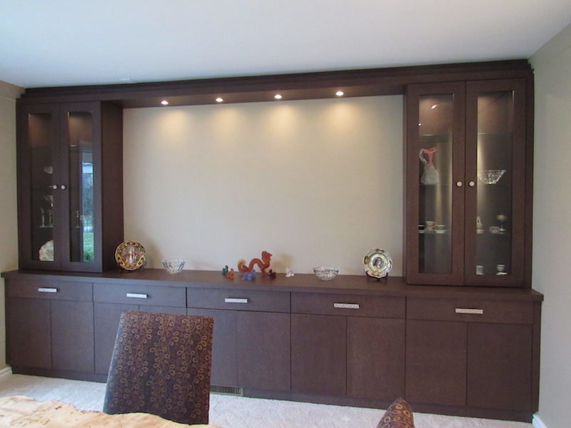 This wall-to-floor ceiling unit offers tons of storage and lots of lighted display! The open center can house a large-screen TV or more artwork.