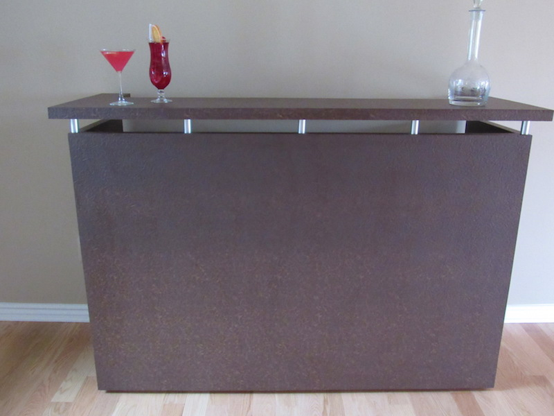 This wonderful bar is on casters so it can be moved to any part of the home when you are entertaining! There is a lot of storage on the opposite side with locked cabinets.