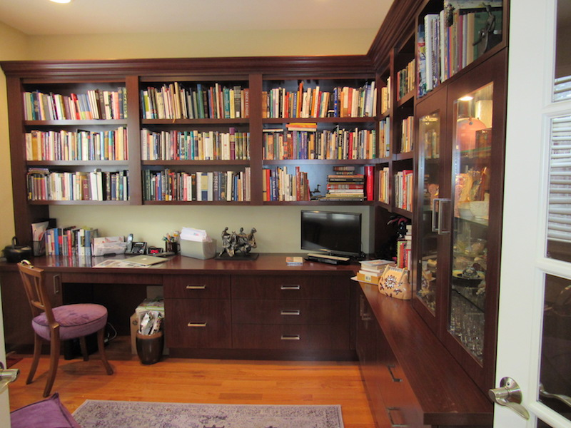 This home office has lighted under bookcase shelves with lots of storage. Most equipment is hidden on pull-outs with lots of hidden ports throughout. Lighted framed equipment display area for crystal objects is included.