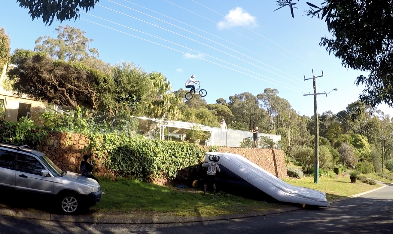Fast enough to make the gap but low enough to miss the powerlines! Pictured: DD AirBags NextStep BMX Lander