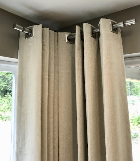 Square Grommet Draperies On Brushed Metal Hardware