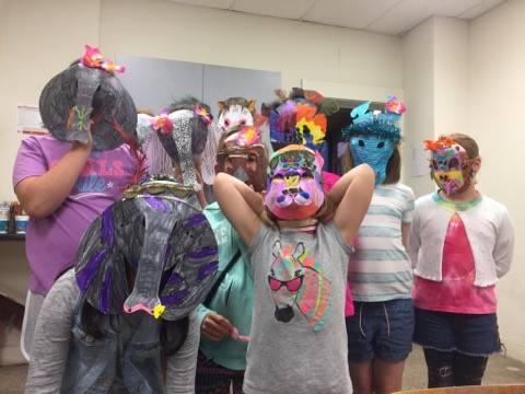 Kids wearing masks they made.jpg