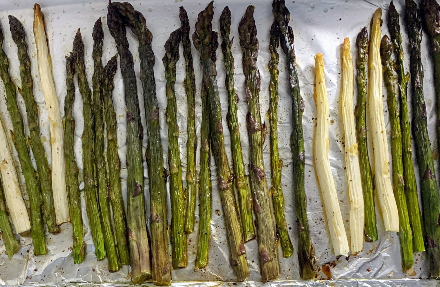 Grilled asparagus - olive oil, salt and pepper, and a 350 F oven is all that is needed for a deliciously grilled asparagus.