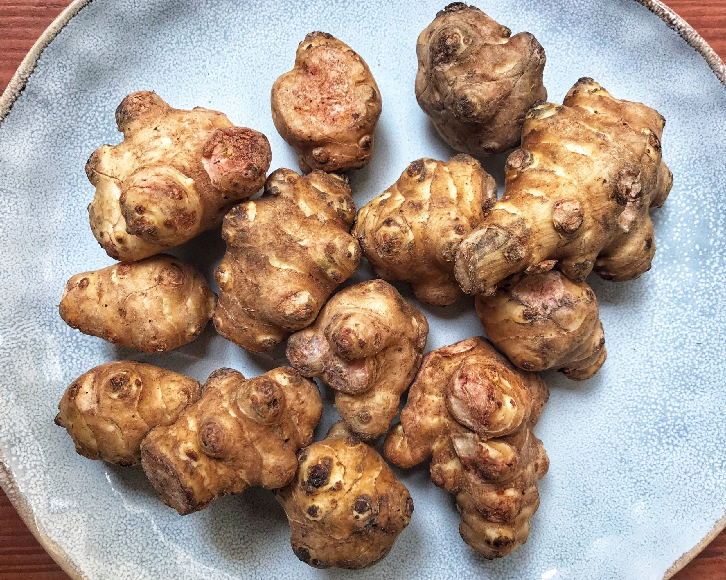 Jerusalem artichoke - also called sunroot, sunchoke, or earth apple, is a species of sunflower native to eastern North America, and found from eastern Canada and Maine west to North Dakota, and south to northern Florida and Texas.Source: Wikipedia.