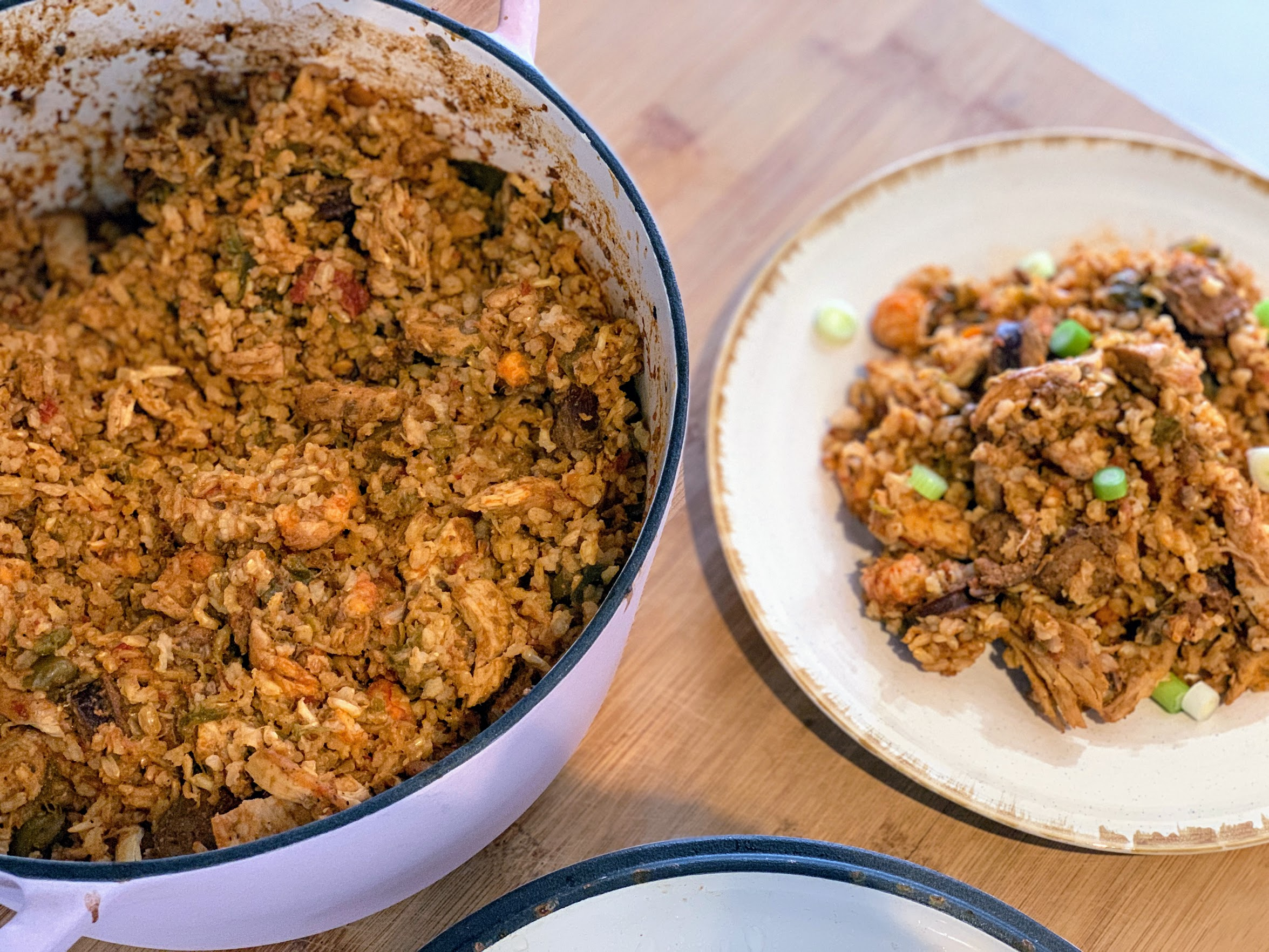 Summer jambalaya with okra, mirepoix, duck fat, ripe tomatoes, spices and 3 types of meat.