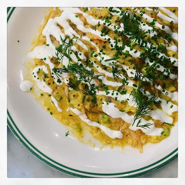 I love eggs. This dish with its slightly runny scramble, caramelized onions, subtle salmon, fresh lemon and horseradish hits the spot for lunch or dinner any day of the week.  1 tbs organic safflower oil, 1 small onion thinly sliced and caramelized (8mins over medium heat), 3 organic eggs slightly beaten, salt and pepper. Cook 5 minutes under medium heat or until as firm as you like. Top with house cured salmon or lox. Drizzle with horseradish sour cream sauce (see note below) and sprinkle with a generous amount of chives and dill. To make horseradish sauce, mix 1 teaspoon of minced horse radish (fresh is better, I always find it at Whole Foods near the refrigerated root vegetables), 1 teaspoon lemon zest, 1 teaspoon lemon juice, 3 tablespoons regular or vegan organic sour cream, and a pinch of salt or more to taste. Mix and add more lemon juice if it is too thick. —- In praise of onions. I have to admit that until a few years ago I only ate onions cooked, as in completely dissolved in the stew for which they were a base... or the occasional fried onion ring (in buttermilk batter). I wasn't a fan of raw onions or slightly sautéed onions like the ones served with most fajitas, Indian tandoori dishes or Thai entrees. But somewhere along the way I started noticing varieties and preparation of onions that I liked. Quick pickled onions for example were introduced to me in a fried chicken sandwich in Austin Texas, raw wild onions and their shoots were introduced to me in Noma Copenhagen, and sweet white onions ceviche style in Miami. Those are just a few examples of dishes that have changed my palate and my mind when it comes to onions. Now I enjoy a little onion juice on my burger and always have a jar of pickled radishes and onions in my fridge, and when ramps are in season I am hard pressed not to add them to everything. . #f52spice #foodlore #feedfeed #imsomartha #dinner #mykitchen #easydinner #algeria #forkyeah #foodphotography #foodie #food #foodstagram #foodlover #