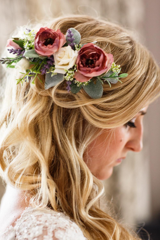 Bridal preparation flower decorations in hair