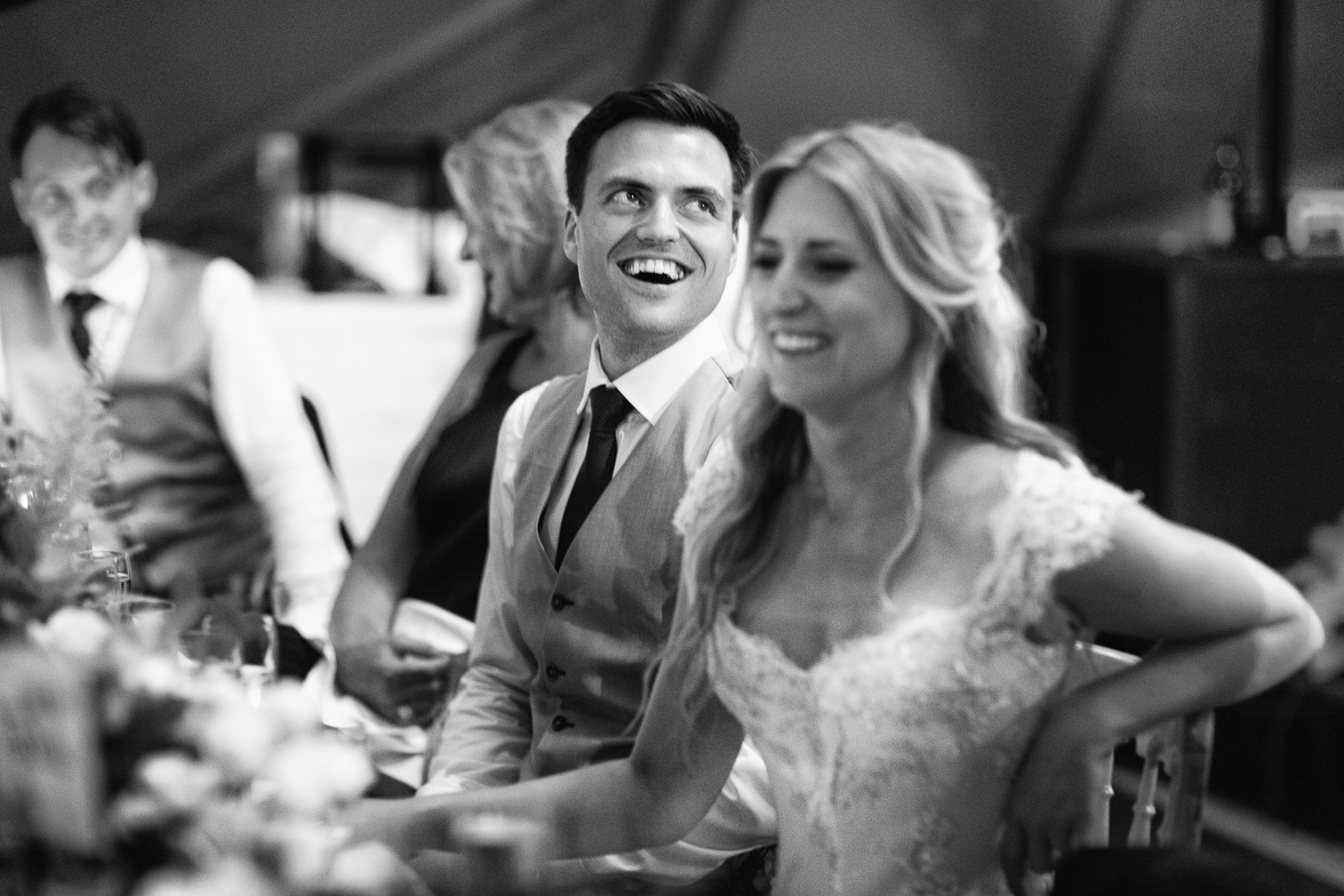 Wedding emotions laughter bride and groom during speeches