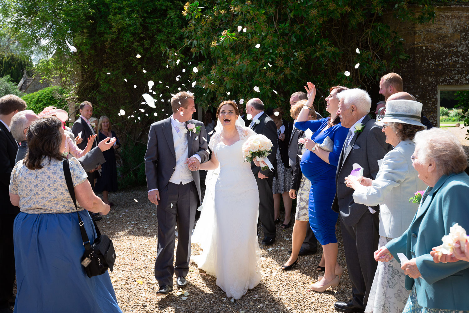 Documentary wedding photography bride and groom in confetti