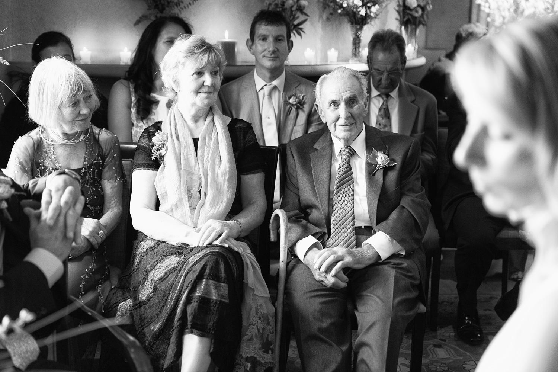 Proud father watching bride at wedding Le Manoir aux Quat'Saisons