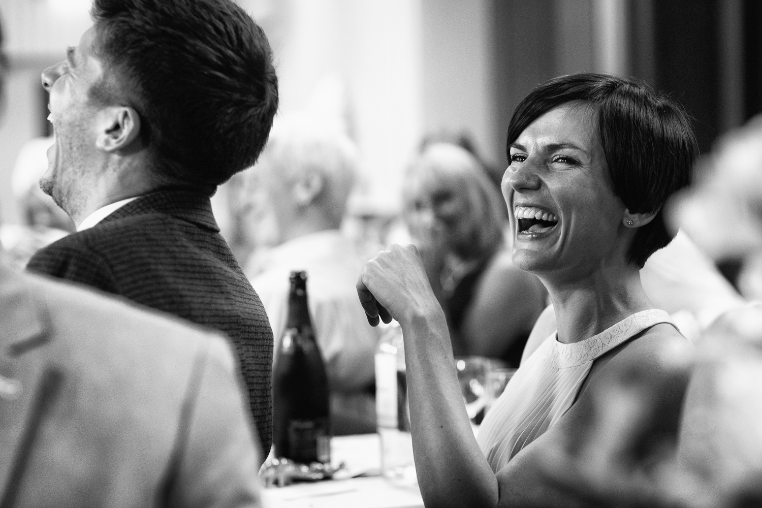 Wedding photography portfolio bride laughing in speeches black and white