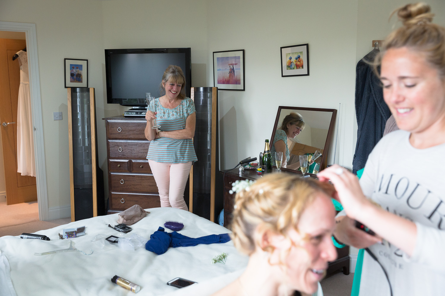 Wedding photography portfolio mother of the bride watching hairdresser