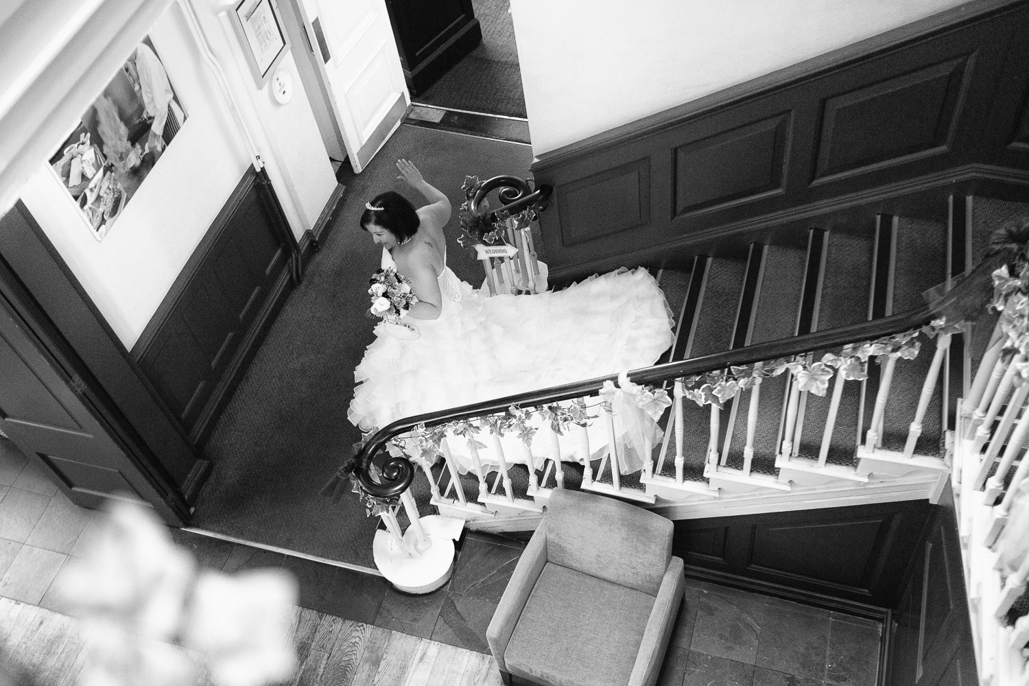 Wedding photography portfolio bride descending stairs beautiful dress
