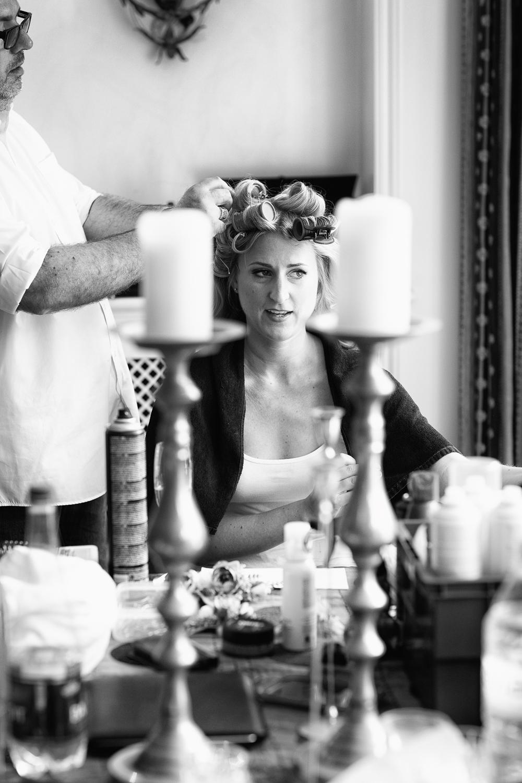 Reportage wedding photography bridal prep hairdresser