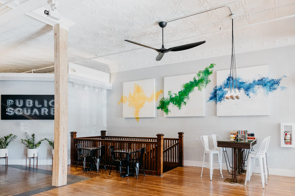 106 Public Square - bright room with ceiling fan and art on wall.