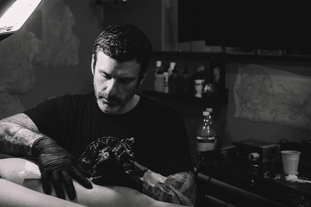Erik Rieth - Erik Rieth is the owner and founder of Ghost in the Machine and has been tattooing since 1992. With an awareness and respect for tradition Erik continues to evolve his unique contemporary style primarily in Americana and Japanese tattoos. He has tattooed professionally in Canada, throughout western Europe, Hawaii, and both coasts of the US. With the founding of Ghost in 2017 he planted his flag in Boston with the determination that it would become one of the premier shops in New England, and has attracted some of the finest artists in the area to make this a reality.