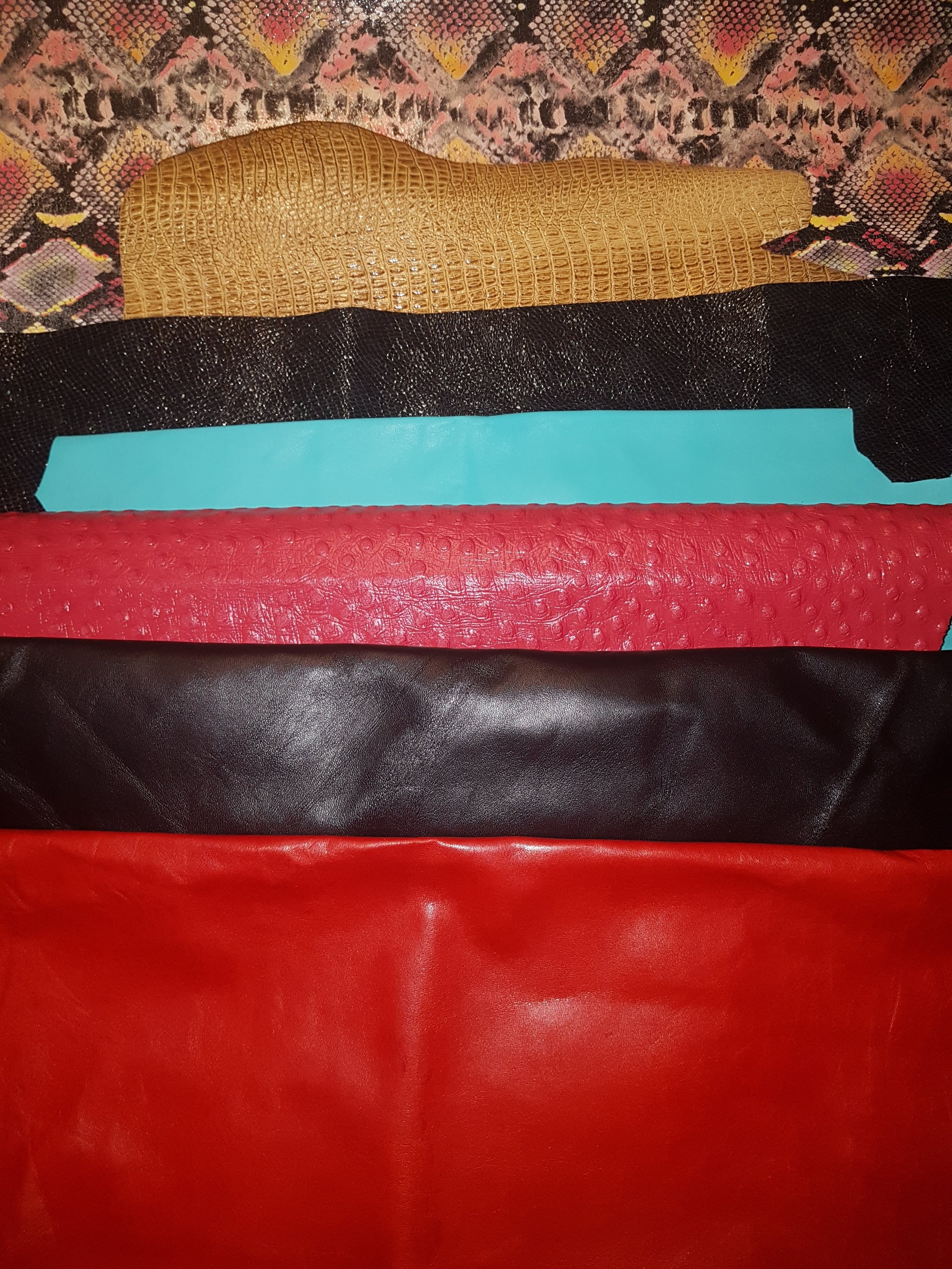 Batch8: - Various mediums and colors of leather. The black, red, turquoise are soft lamb skin leathers. There is a red Ostrich skin embossed leather and a gold alligator embossed leather. How about being bold and try a snake skin patterned (Cow hide) tack set?