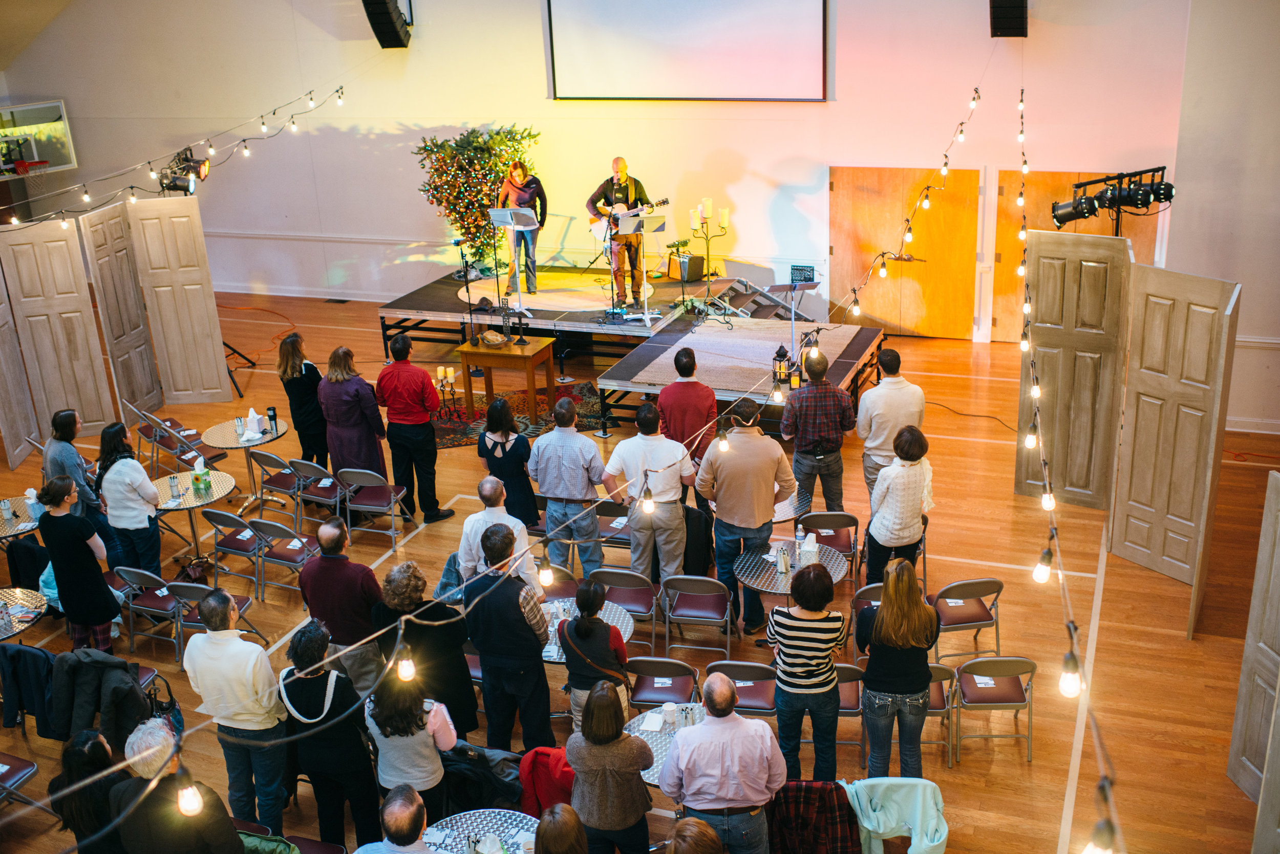 edges moves upstairs - in 2015, we outgrew the basement, so we moved upstairs! to make the new worship space seem less huge to our still-small group, we set up doors on the sides of the room.